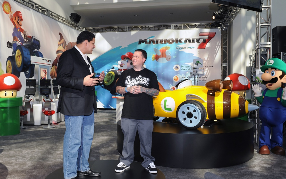 In this photo provided by Nintendo of America, Reggie Fils-Aime, president and COO of Nintendo of America, and Ryan Friedlinghaus, founder and CEO of West Coast Customs, unveil two life-size Mario Kart-themed vehicles during a presentation at the LA Auto Show on Nov. 17, 2011. Nintendo teamed up with West Coast Customs to create the vehicles in celebration of the Dec. 4 release of Mario Kart 7 for the portable Nintendo 3DS system. (AP Photo/Nintendo, Bob Riha, Jr.)  No Sales